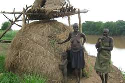 Kwegu and Mursi villagers, Lower Omo valley, Ethiopia.