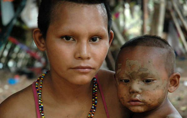 Nukak mother and child having fled Colombia&apos;s civil war to a nearby town