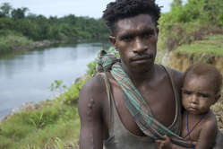 A Korowai man and child in West Papua