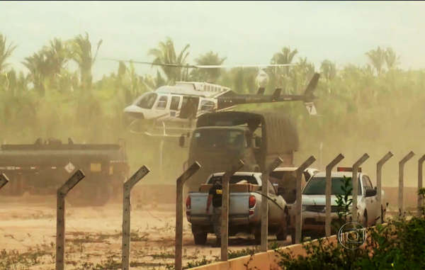 Army helicopters and trucks move in as part of the operation.