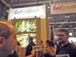 Protestors called on visitors at the Fitur travel fair in Madrid to support Survival's tourism boycott