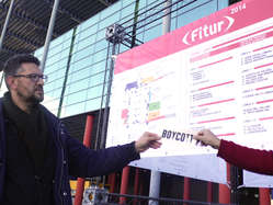 In Madrid protestors handed out leaflets at the Fitur travel fair.
