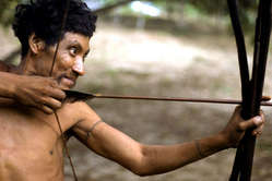 Awá man with bow and arrow, Posto Tiracambu, Caru, Brazil, 2000.