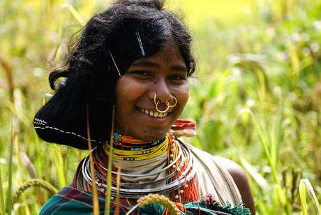 Dongria Kondh woman in millet field, Orissa, India