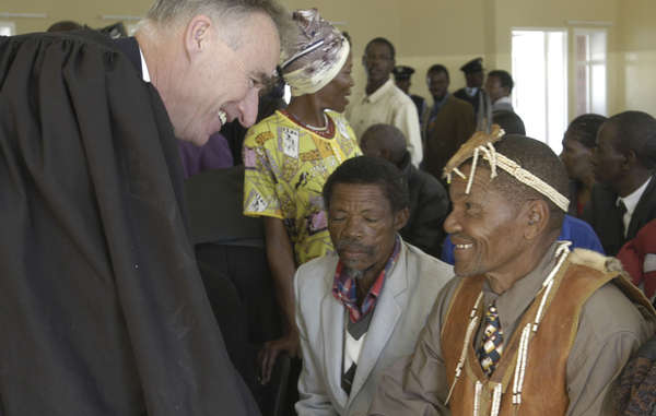 The Bushmen's lawyer Gordon Bennett with his clients in 2004. He has since been barred from entering the country.