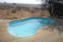 The pool of Wilderness Safaris' new lodge in the Central Kalahari Game Reserve, Botswana. The tourist lodge was developed and built without the consent of the Bushmen, who have been living on this land for centuries.