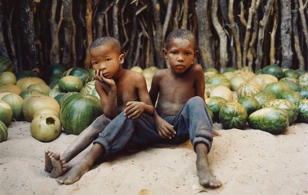 Bushmen children at Molapo in the Central Kalahari Game Reserve, with melons which supply some of their water needs