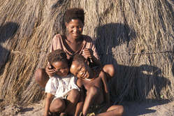 Bushman mother and children at Gope, before their eviction to a resettlement camp