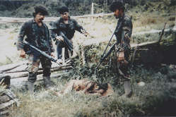 'Trophy' photograph taken by an Indonesian soldier after he and his comrades murdered Ninuor Kwalik and his 12 year old nephew Daugunme in 1998, West Papua.