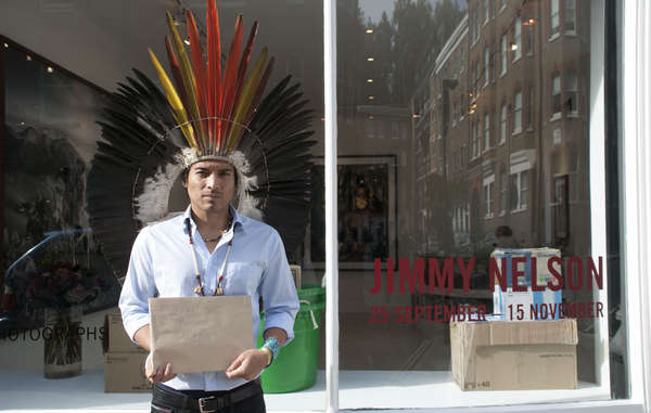 """Nixiwaka Yawanawá protested against the 'outrageous' exhibition of Jimmy Nelson's work at London's Atlas Gallery, wearing his ceremonial headdress."""