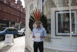 Amazon Indian Nixiwaka Yawanawá handed a letter to London's Atlas Gallery stating 'We are not passing away, we are struggling to survive.'