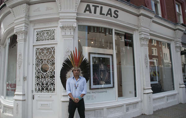 "Nixiwaka Yawanawá protested against the ""outrageous"" exhibition of Jimmy Nelson's work at London's Atlas Gallery, wearing his ceremonial headdress."