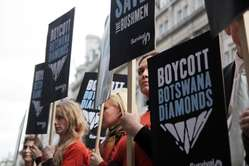 Survival International is calling for a boycott of Botswana diamonds until the Bushmen are allowed water.