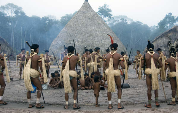 Enawene Nawe men perform the Ykwa ritual,a four-month exchange of food between humans and the ancestral spirits, accompanied by dancing and chanting to the sound of flutes,Brazil.