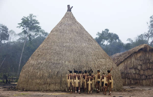 """Enawene Nawe men perform the Yãkwa ritual, a four-month exchange of food between humans and the ancestral spirits, accompanied by dancing and chanting to the sound of flutes."""