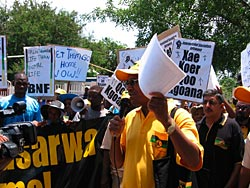 Protestors carrying placards during the demonstration in Gaborone