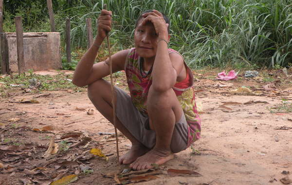 Uncontacted Awá Indians Irahoa and two relatives made contact with a settled community. Their forest has been invaded by loggers, who have attacked the Awá in the past.