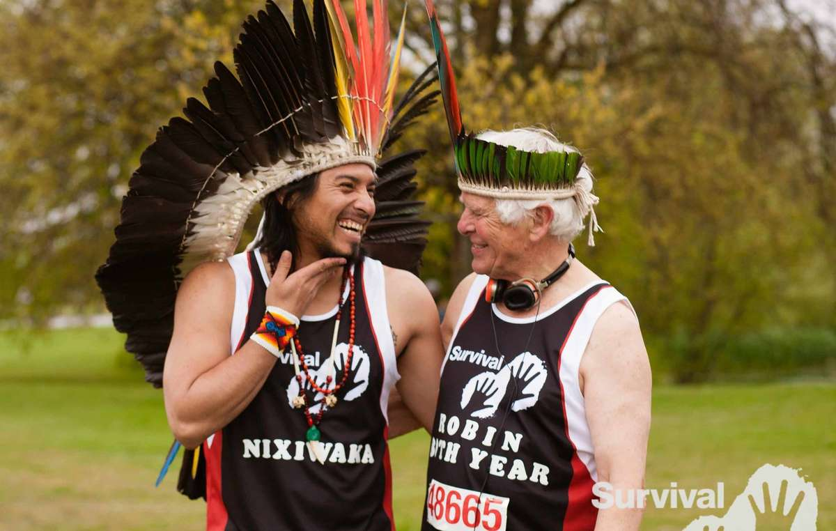 Survival President Robin Hanbury-Tenison and Nixiwaka of the Amazon's Yawanawa people after completing the London Marathon.