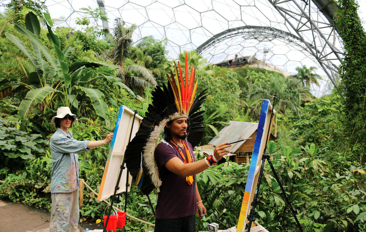 Amazon Indian Nixiwaka Yawanawá and painter John Dyer painting in the Eden Projects Rainforest Biome.