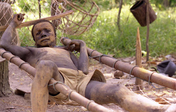 A man from the Onge tribe relaxing in his hammock, Andaman Islands.