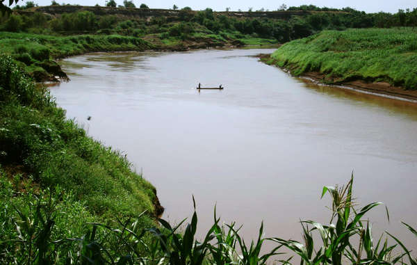 Kwegu men, fishing on the Omo River, Ethiopia.