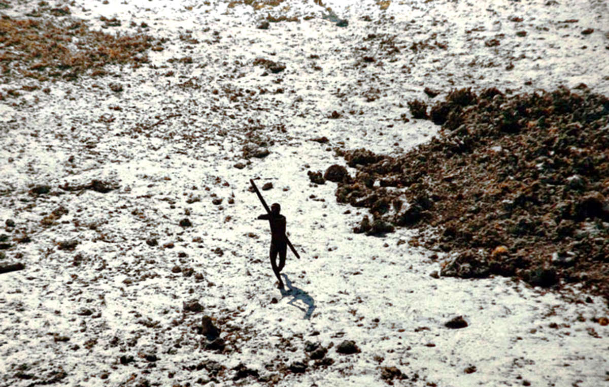 This member of the Sentinelese tribe was photographed firing arrows at a helicopter which was sent to check up on the tribe in the wake of the 2004 tsunami . The Sentinelese people have long made it clear that outsiders are not welcome and they wish to be left alone.