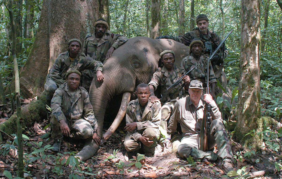 "Peter Flack (front right), WWF trustee, with his ""bag"" and de Gentile Duquesne (back right), the latter killed an ""elephant poacher"" as well as elephants."
