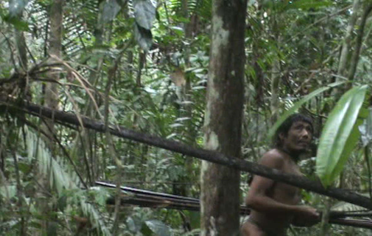 The last of the Kawahiva are forced to live on the run from armed loggers and powerful ranchers (image taken during a chance encounter with Brazilian government agents).