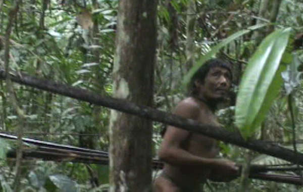 The Kawahiva have been forced to live on the run in the Amazon for years. This image is a still taken from footage filmed by a Brazilian government task force during a chance encounter