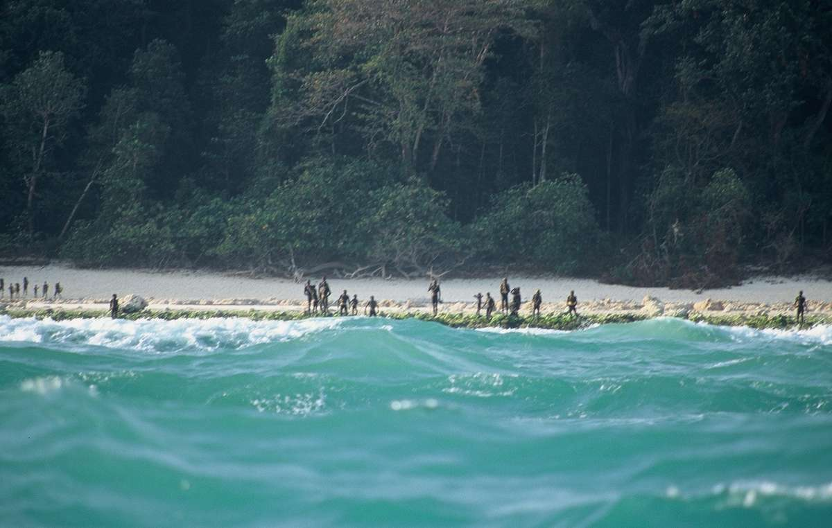 The Sentinelese stand guard on an island beach.