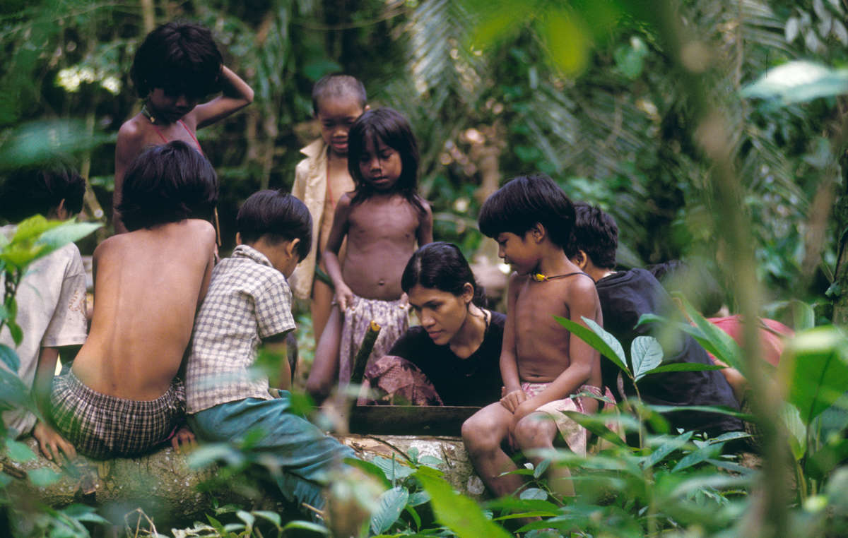 Orang Rimba children learning with Sokola Rimba (The Jungle School), Indonesia