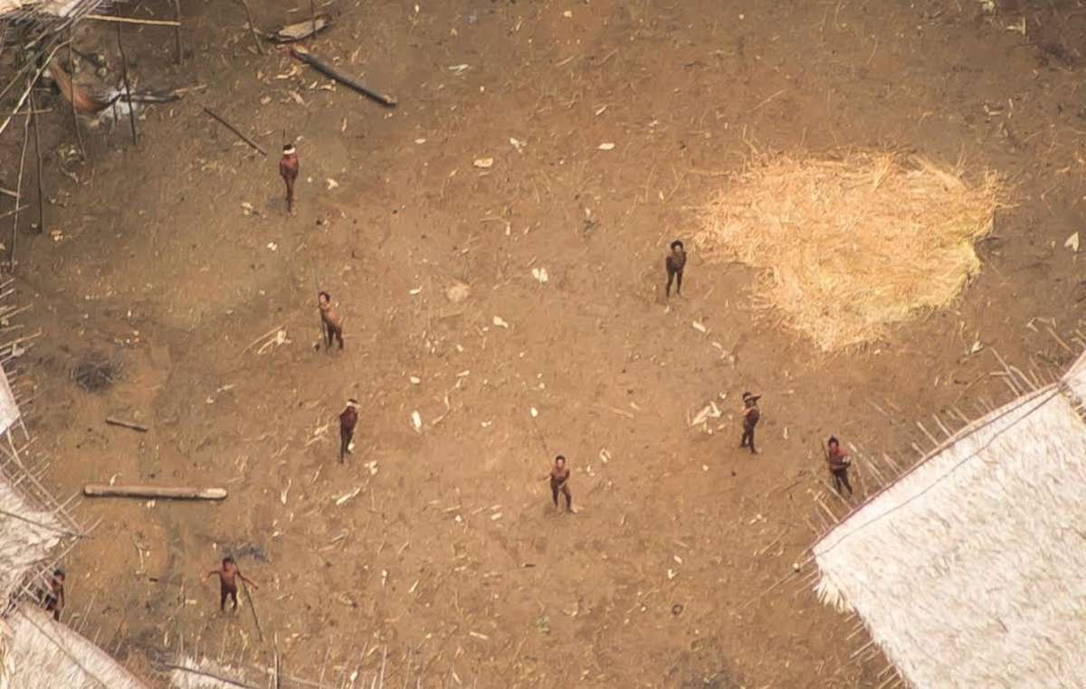 Uncontacted Yanomami Indians photographed from the air near the Venezuelan border. They appear to be in good health, and their population appears to have grown.