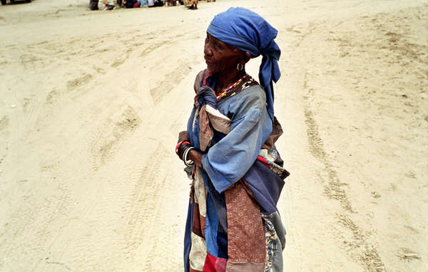 A Bushman woman in the street in New Xade, the government resettlement camp to which many Bushmen have been relocated in the last ten years.