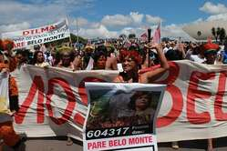 Amazon Indians protesting in Brasília against the Belo Monte mega-dam project, Brazil. Numerous tribal peoples' lives and livelihood are under threat due to the construction of this dam, which would be the world's third largest dam upon completion.