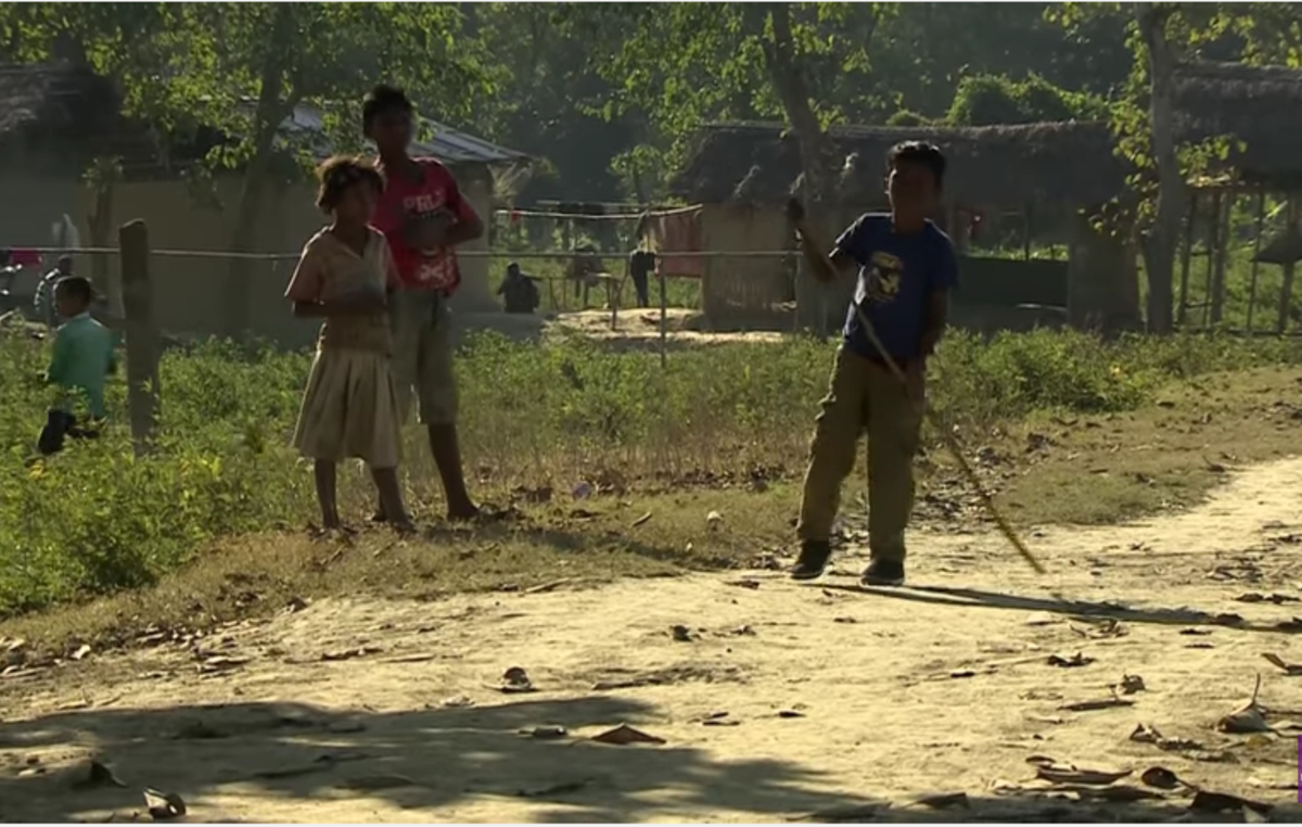 Akash Orang, a tribal boy, now struggles to walk after being shot by guards in Kaziranga.