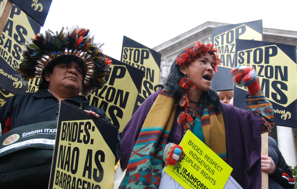 Indigenous leaders Almir Surui and Sheila Juruna protest against Brazil's state development bank BNDES, which is providing much of the funding for the mega-dams planned in the Amazon region. These dams threaten the lives, homes and livelihood of thousands of tribal peoples.