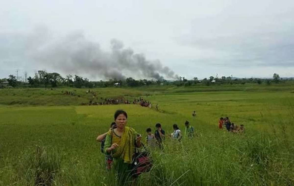 Jumma villagers flee from an attack, Chittagong Hill Tracts, Bangladesh
