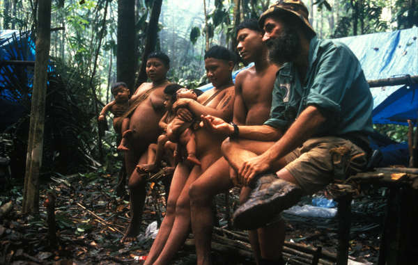 Ethnographer and former head of FUNAI's isolated Indians unit, Sydney Possuelo, with Korubo Indians in the Amazon rainforest, Brazil. FUNAI made the first contact with the Korubo tribe in 1996.