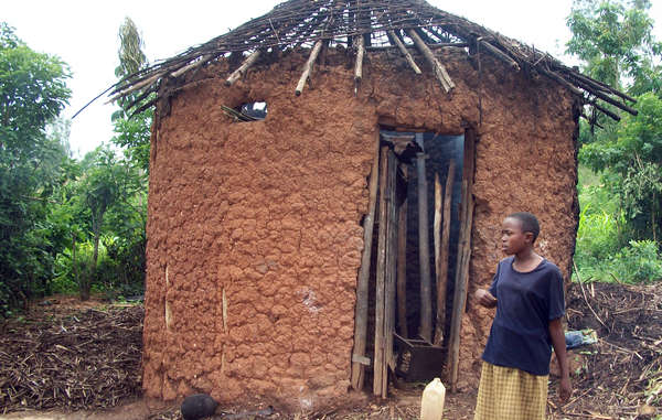 The roof of this Batwa hut was destroyed as part of a government scheme to rid Rwanda of all thatched housing. Hundreds of Batwa families have been left without shelter as a result.