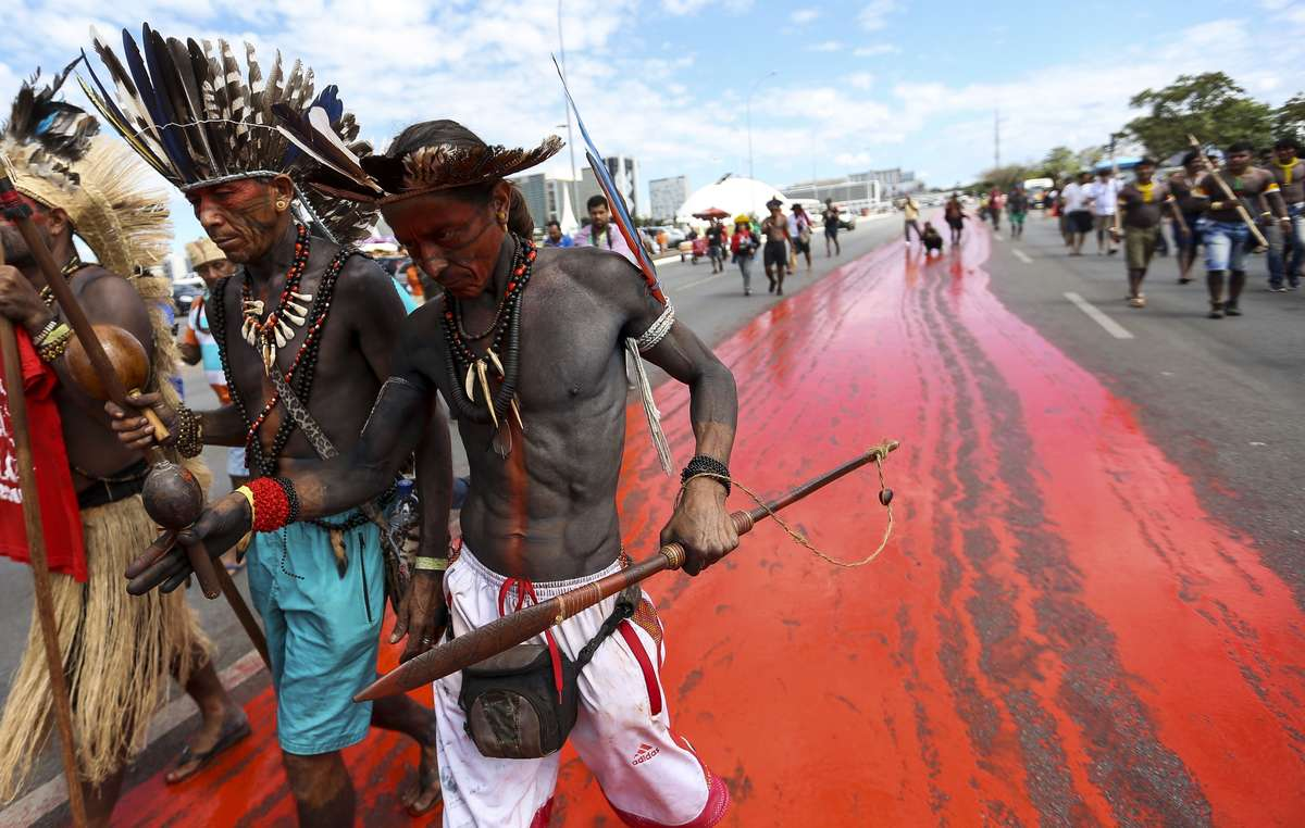Image from indigenous protests in Brasilia, April 2018. By staining the streets red, we are showing how much blood has been shed in our fight for the protection of indigenous lands. said Sonia Guajajara, an indigenous leader