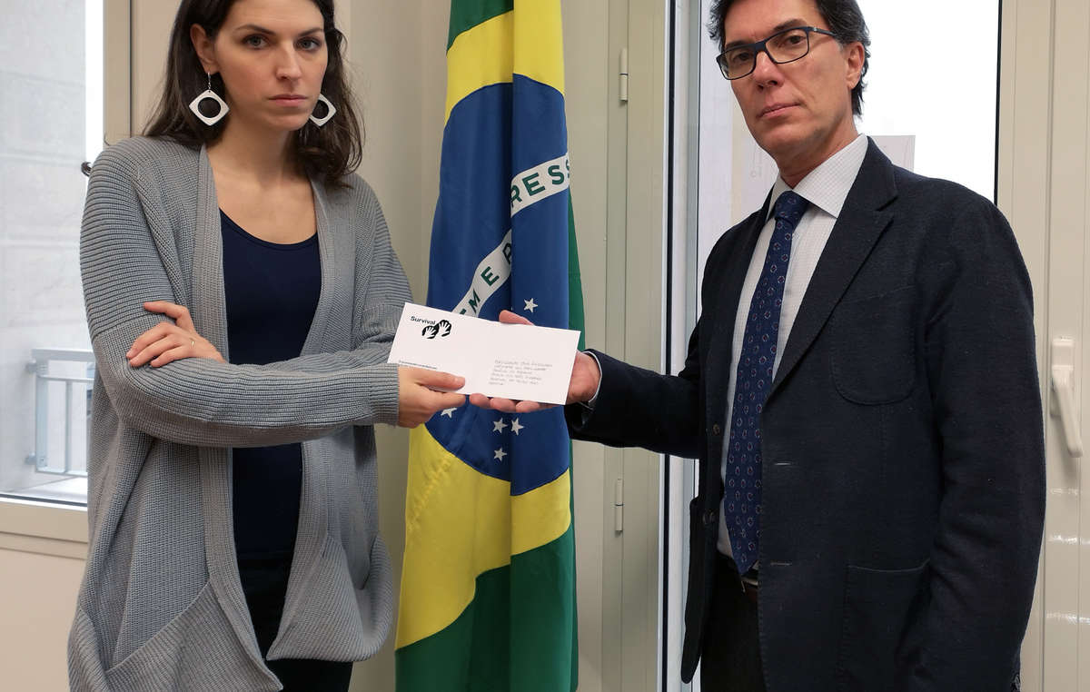 Survival protester hands in a letter to the Brazilian Consulate in Milan, Italy.