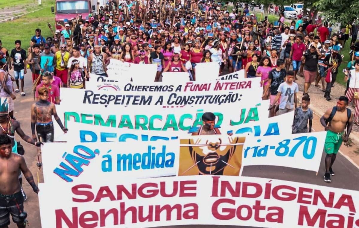Protesters marching for indigenous rights in Brazil
