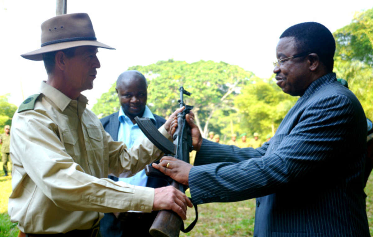 Congolese officials hand the top official (and WWF employee) of Salonga National Park an assault rifle. Some of the parks guards have been accused of gang rape, torture and murder.