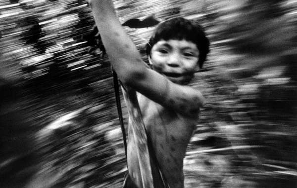 Yanomami boy in the rainforest, Brazil.