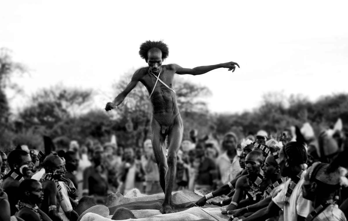 A Hamar man in Ethiopias Lower Omo Valley has to jump over a line of cattle four times before getting married.