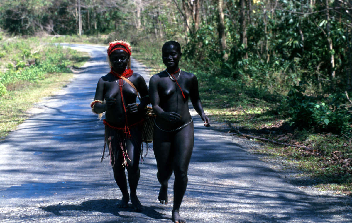 Two Jarawa women on the Andaman Trunk Road which was bulldozed illegally though the Jarawa Tribal Reserve and risks the introduction of diseases to which the Jarawa have no immunity.