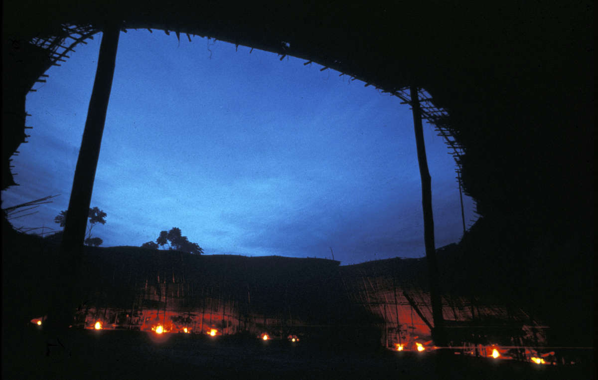 Interior of the Yanomami maloca at night, Tootobi, Brazil.