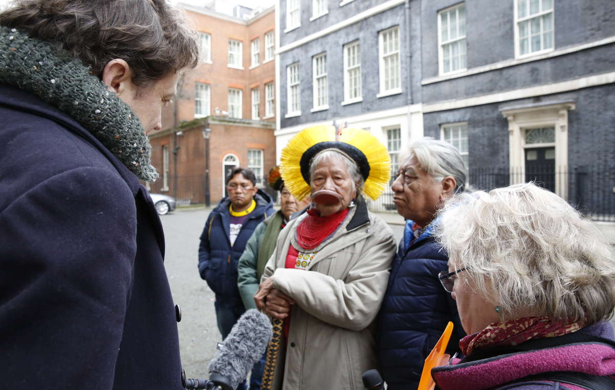 The indigenous leaders and Survival's Fiona Watson interviewed by the media in Downing St.