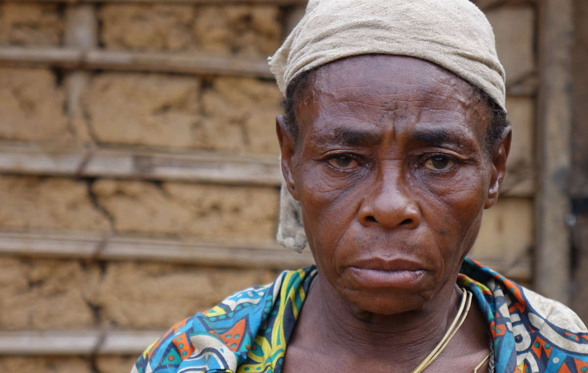A Baka woman whose husband, named Komanda, was arrested by rangers in Messok Dja, then imprisoned on false accusations of poaching. In prison he was brutally assaulted by other prisoners, and died soon after being released.