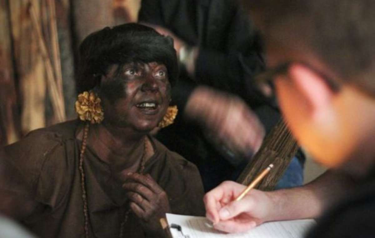 A missionary with blacked-up paint pretends to be a member of the Yanomami people during training promoted by the NTM.